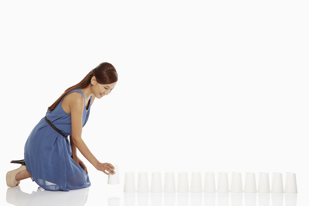 Woman arranging disposable cups