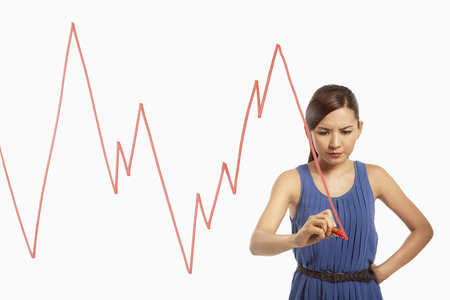 Businesswoman drawing graph chart on a glass