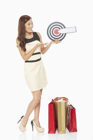 Woman holding a dart board photo