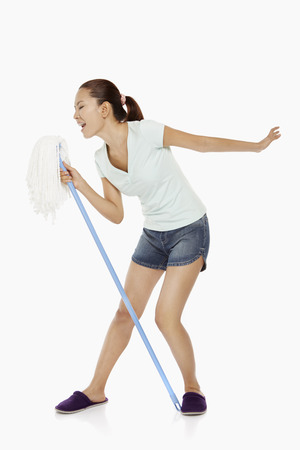 Woman singing into a mop