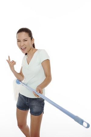 Woman using mop as a guitar