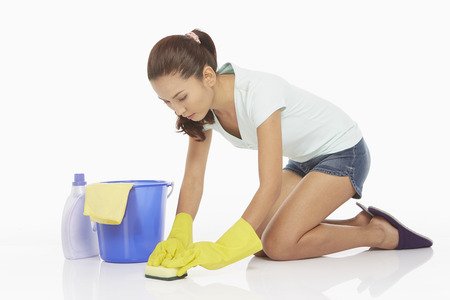Woman scrubbing the floor with a sponge photo