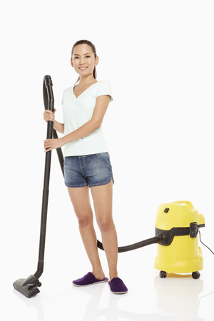 Woman cleaning and vacuuming the floor photo