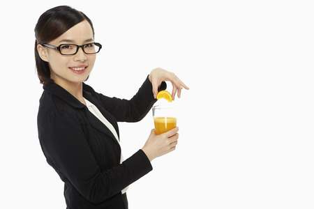 Businesswoman with a glass of orange juice photo