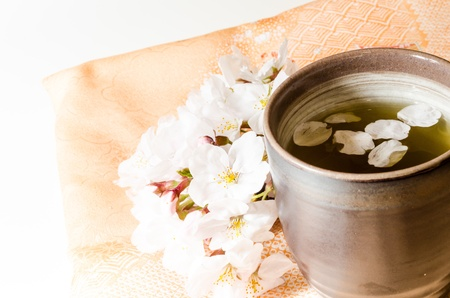 mat like: Japanese teacup and cherry tree  Stock Photo