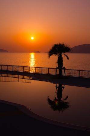 the setting sun: setting sun and a pool