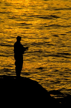 Evening glow and  angler  photo