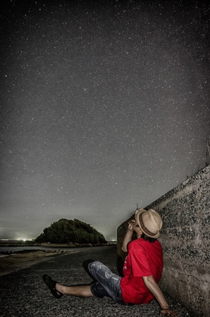 starlit sky: male and starlit sky which play a harmonica