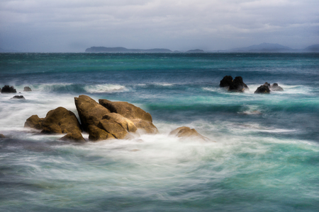 Rough waves on a rocky sea