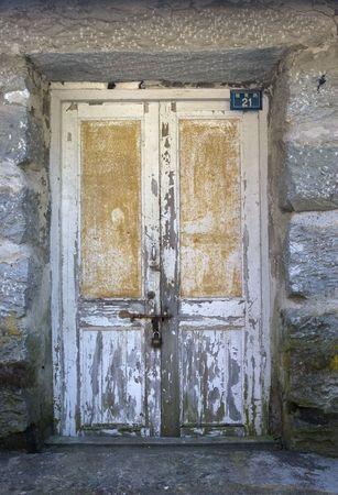 gripe: The locked door of a shop.