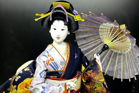 A photo of a geisha doll in japan photo