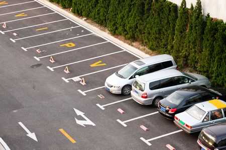the place is outdoor: the cars parking on the outdoor. Stock Photo