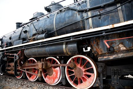 the old black locomotive of the train. photo