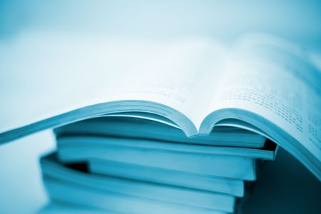 accumulating: book accumulating on the white background. Stock Photo