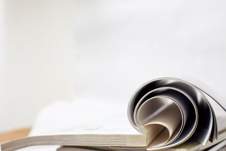 bookbinding: book accumulating on the white background. Stock Photo