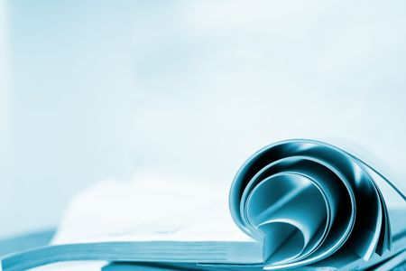book accumulating on the white background. Stock Photo