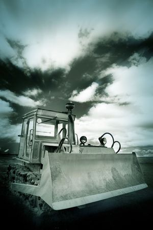 the heavy duty with the clouds background outdoor. photo