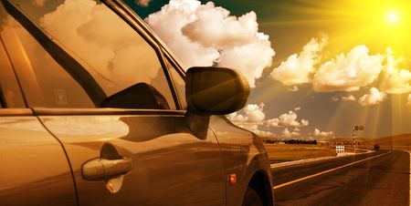 the car on the road with the background of meadow. Stock Photo - 5799383