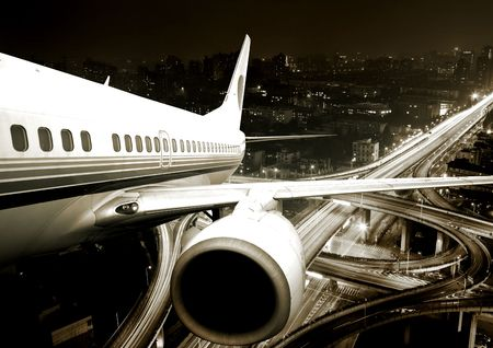 night highway: the airplane take off from the city night.