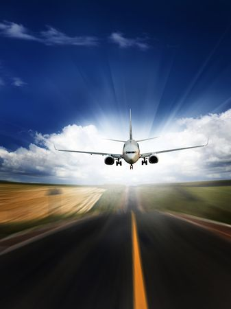the airplane with the blue sky background. photo