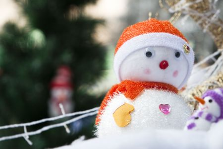 snowman with the christmas background outdoor. photo