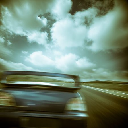 the car running on the road.with the cloudy sky background. photo