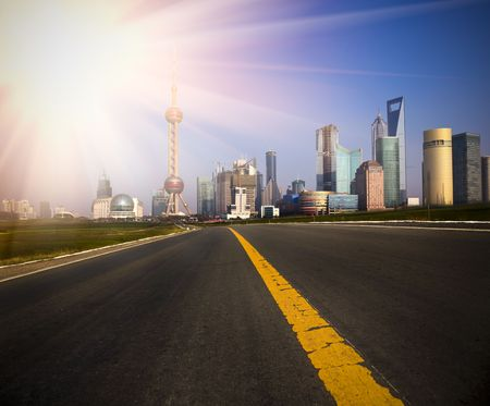 road to shanghai with the background of the landmark in shanghai china. photo