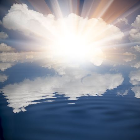 cloudscape: the background of the cloud and its reflection image in the water. Stock Photo