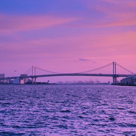 the bridge on the sea in sunset of japan. photo
