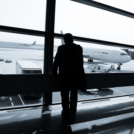 wait sign: the business man at the airport.