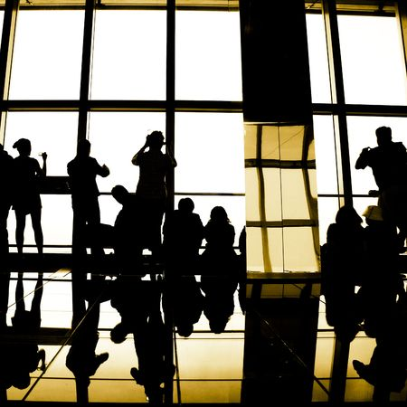 silouette of the traveler in the modern building on the sunset backgroun. Stock Photo - 6485314