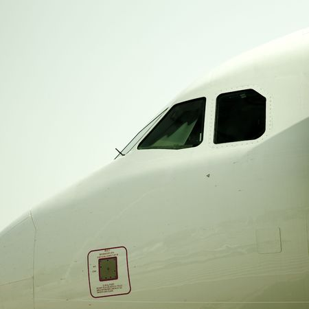 airplane is waiting for departure in pudong airport shanghai china. photo