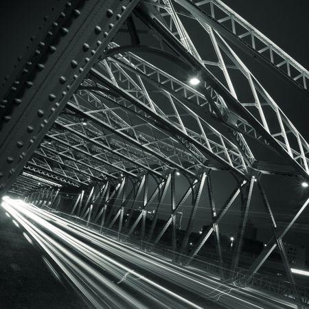 Night traffic lights inside of the Garden Bridge of shanghai china. photo