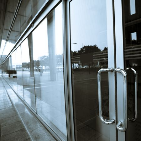 glass door: door of the office building in shanghai china. Stock Photo
