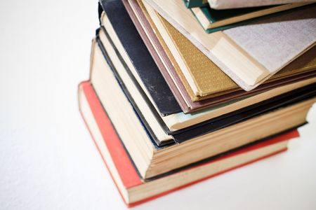 A large stack of old book in home .