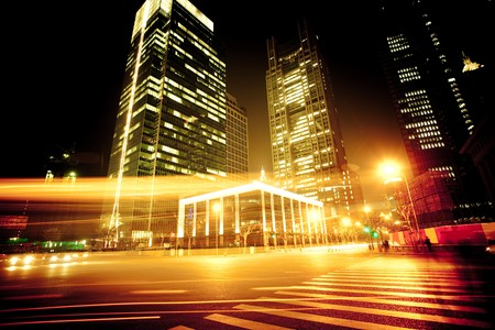 shanghai night: the light trails on the modern building background in shanghai china. Stock Photo