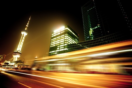 the light trails on the modern building background in shanghai china. 에디토리얼