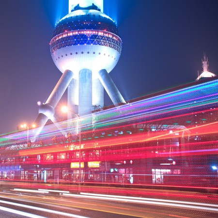 shanghai: the light trails on the modern building background in shanghai china. Editorial