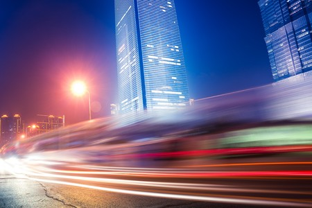 the light trails on the modern building background in shanghai china. Stock Photo - 6999676
