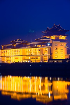 the chinese building in night by the river. photo