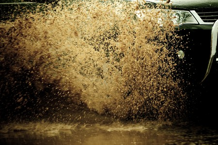 suv splash on the river outdoor ,traveling on the road. Stock Photo - 7000026