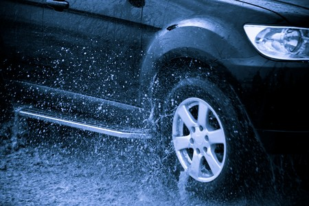 suv splash on the river outdoor ,traveling on the road. Stock Photo - 6999983