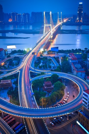 night view of the bridge and city in shanghai china. Stock Photo