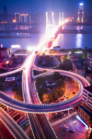 river scape: night view of the bridge and city in shanghai china. Stock Photo