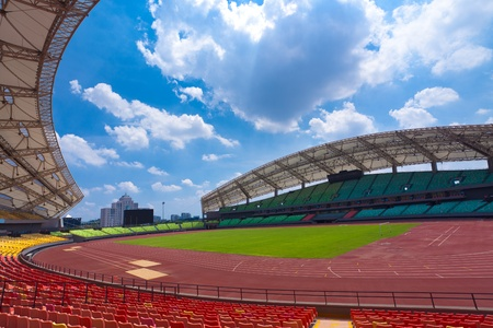 outdoor sports: A field of empty seats in a open stadium in china outdoor. Stock Photo