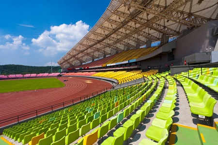 seating: A field of empty seats in a open stadium in china outdoor. Stock Photo