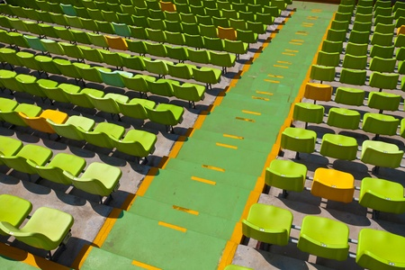A field of empty seats in a open stadium in china outdoor. photo