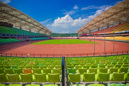 A field of empty seats in a open stadium in china outdoor. Stock Photo
