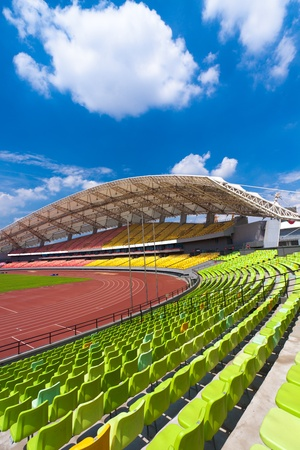 no cloud: A field of empty seats in a open stadium in china outdoor. Stock Photo
