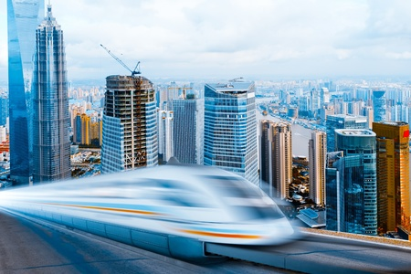 very high-speed train go through the  shanghai lujiazui financial center . Reklamní fotografie
